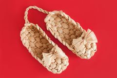 Russia lapty is rural shoes on the red stock photography