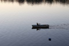 Russia: A lonely man floating in a boat royalty free stock photos