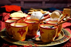 Russia, Magnitogorsk, - June, 15, 2019. Koumiss - mare`s milk in traditional national wooden cups and dishes of Bashkir and Tatar. Cuisine during Sabantuy - the stock photography