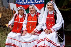 Russia, Magnitogorsk, - June, 15, 2019. Women in bright national costumes of Bashkortostan and Tatarstan - participants of the stock photography