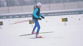 Russia, 05 March 2018, Biathlon training process. Biathlon practice and a female biathlete participating in it. Biathlon practice and a female biathlete stock video footage