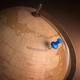 Russia Marked. Antique globe with the Russia marked by the pin. Clipping path included Royalty Free Stock Photo