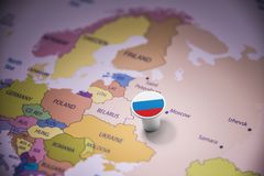 Russia marked with a flag on the map.  royalty free stock images