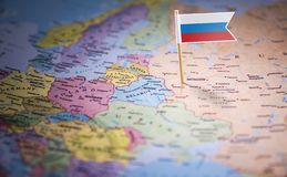 Russia marked with a flag on the map.  royalty free stock photos