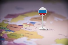 Russia marked with a flag on the map.  stock photo