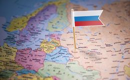 Russia marked with a flag on the map.  royalty free stock photography