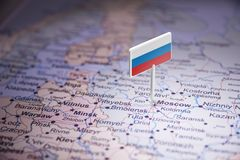 Russia marked with a flag on the map.  stock photography