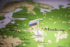 Russia marked with a flag on the map.  stock image
