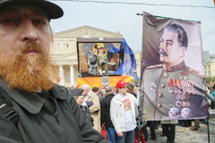 Russia May Day.Communist party supporters take part in a rally. (portrait of Soviet dictator Josef Stalin) Stock Photos