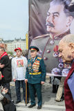 Russia May Day.  Communist party supporters take part in a rally. (portrait of Soviet dictator Josef Stalin) Royalty Free Stock Photography