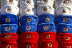 Russia military hats. Many colored in Russian tricolor military hats Soviet and Russian army at Moscow`s street Royalty Free Stock Photos