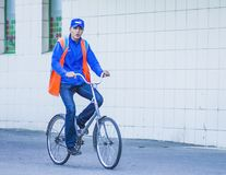 Guy rides a bike on the sidewalk stock photography