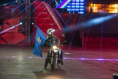 With a flag and a motorcycle. RUSSIA, MOSCOW - APRIL 1, 2017: the auto show Moscow police at the 10 festival of extreme sports in the Olympic Sports Complex Royalty Free Stock Photography