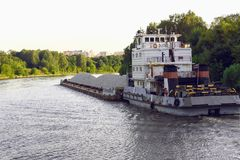 Russia, Moscow August 2018: a barge with a load of rubble floating along the river channel. Of Moscow royalty free stock images