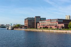 Russia, Moscow August 2018: Building of a modern residential complex on the river bank. View from the boat stock image