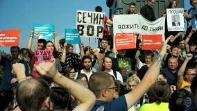 RUSSIA, MOSCOW - AUGUST 09, 2018: Rally Against Pension Reform. The crowd shouts: AUTHORITY - TO ANSWER. RUSSIA, MOSCOW - AUGUST 09, 2018: Rally Against Pension stock footage