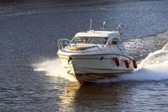 Russia, Moscow August 2018: small high-speed boat sails on the river. Channel of Moscow stock photos