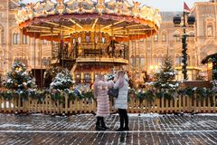 Russia, Moscow, Christmas market on Red Square. Russia, Moscow, 19.12.2017: New Year`s Fair, Christmas market on Red Square. Young beautiful girls are royalty free stock photo