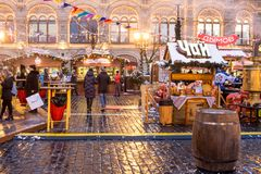 Russia, Moscow, Christmas market on Red Square. Russia, Moscow, 19.12.2017: New Year`s Fair, Christmas market on Red Square. Young beautiful girls are stock photography