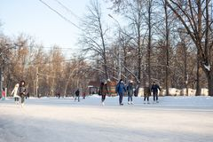 People is skating on a huge free ice rink in Sokolniki Park Stock Photography