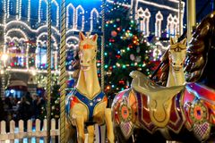 Colorful carousel before Christmas on the Red square of the Kremlin. Fabulous, night lighting, walking people stock photography