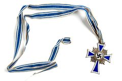 RUSSIA, MOSCOW - DECEMBER, 2017: Cross of Honour of the German Mother isolated on white. State decoration conferred by the governm stock photos