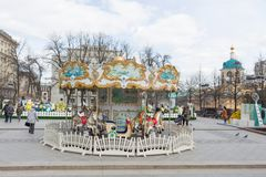Russia, Moscow: Easter festive decoration and children`s carouse. Russia, Moscow, April 20, 2017: Easter festive decoration and children`s carousel of the square Royalty Free Stock Images