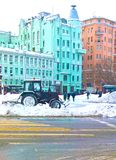 Russia, Moscow, editorial, tractor with a shovel for snow removal. In the city center day cleans the road Royalty Free Stock Images