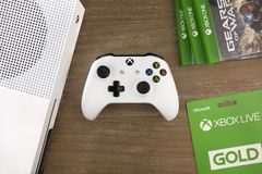 RUSSIA, MOSCOW, JANUARY 2017 View from the top on xbox one s gamepad, xbox one s game console and game discs. View from the top on xbox one s gamepad, xbox one s Stock Images