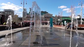 Russia - Moscow, 12 June 2018: Colour dancing street fountain at the street of the city. Water dance and changes it`s stock video footage