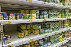 RUSSIA, MOSCOW, JUNE 11, 2017: Different kind of canned green peas on the shelves in the supermarket Auchan Stock Photo