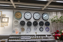 RUSSIA, MOSCOW, JUNE 13, 2017: Many wall clock on the wall in Ikea store Stock Photography