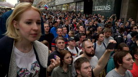 RUSSIA, MOSCOW - JUNE 12, 2017: Rally Against Corruption Organized by Navalny on Tverskaya Street. A girl from the crowd stock video footage