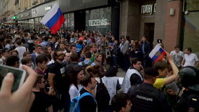 RUSSIA, MOSCOW - JUNE 12, 2017: Rally Against Corruption Organized by Navalny on Tverskaya Street. The police removes stock footage