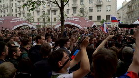 RUSSIA, MOSCOW - JUNE 12, 2017: Rally Against Corruption Organized by Navalny on Tverskaya Street. The police removes the detainee. RUSSIA, MOSCOW - JUNE 12 stock video