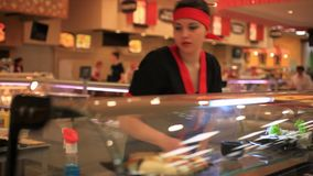 RUSSIA, MOSCOW, 7 MARCH 2015, chef puts sushi for stock footage