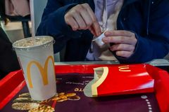 Russia, Moscow March 2019. Macdonalds`s food eating closeup royalty free stock photo
