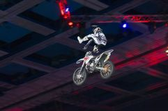 Performing an exercise rider. RUSSIA, MOSCOW-MARCH 2: Unidentified sportsman doing tricks on his bike at the VI festival of extreme sports in the Olympic Sports Royalty Free Stock Images