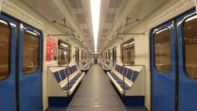 Russia, Moscow - May 06, 2019: Absolutely empty carriage of the Moscow metro. Made in blue and white colors, blue chairs and doors.  royalty free stock image