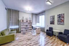 Living room interior in modern house. Russia Moscow - Modern interior design living room, urban real estate Stock Image