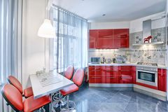 Kitchen interior in red color modern house. Russia Moscow - Modern interior kitchen design of urban real estate Royalty Free Stock Image