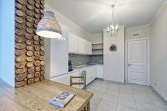 Modern design white kitchen in a spacious apartment. Russia Moscow - Modern interior kitchen design of urban real estate Royalty Free Stock Image