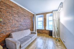 Interior room modern house. Russia Moscow - Modern interior room design with brick wall in an urban estate Stock Images