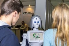 Live and interesting communication between a person and a robot. Russia, Moscow, 25 november 2017. Exhibition: ROBOTICS EXPO 2017. International Exhibition of Royalty Free Stock Photo