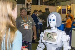 Live and interesting communication between a person and a robot. Russia, Moscow, 25 november 2017. Exhibition: ROBOTICS EXPO 2017. International Exhibition of Stock Image