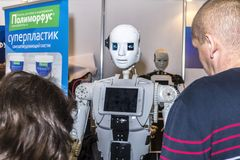 Live and interesting communication between a person and a robot. Russia, Moscow, 25 november 2017. Exhibition: ROBOTICS EXPO 2017. International Exhibition of Stock Photos