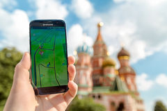 Russia, Moscow, Red Square - August 25: 2016 Smartphone with Pokemon Go application. An Android user plays , a augmented Royalty Free Stock Photo