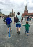Russia, Moscow, Red Square 2018. Father and two sons stock photo