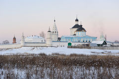Russia. Moscow region. Bobrenev monastery. Russia. Moscow region. Town of Kolomna. Ensemble of Bobrenev monastery in snow at a sunset. Winter postcard royalty free stock image