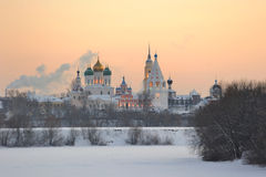 Russia. Moscow region. Ensemble of Kolomna Kremlin. Russia. Moscow region. Town of Kolomna. Ensemble of Kolomna Kremlin at a sunset across frozen Moskva river in Royalty Free Stock Photo